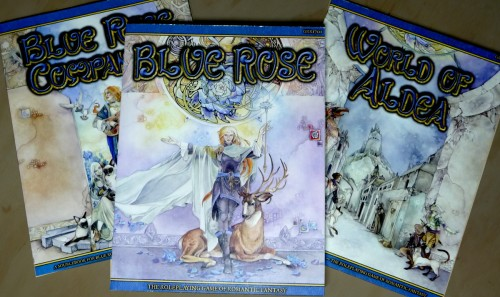 The Blue Rose RPG and two companion books.